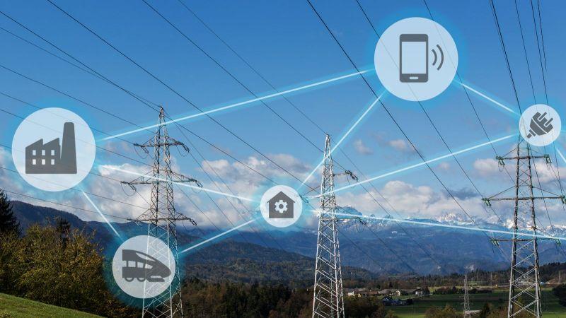 Symbole für Vernetzung vor Landschaft mit Strommasten